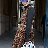 A polka-dot clutch and reflective shades added a cool blue touch to this leopard-print ensemble.