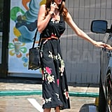 Miranda Kerr stepped out in a floral midi dress.