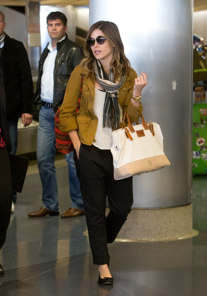 While arriving at LAX airport, Sophia layered up with a safari jacket,  striped fringe Co-Op scarf, loose-fitting black pants by Wheat Civilian, and a canvas Apolis bag ($218). A gold watch and round sunglasses completed her travel-cool look.  7092292