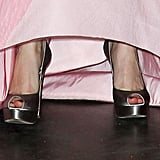 Michelle's peep-toe silver shoes.