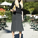 Play it one part casual, one part sophisticated with a relaxed tee up top and a ladylike skirt on bottom, then tie it all together with a pair of heeled loafers.