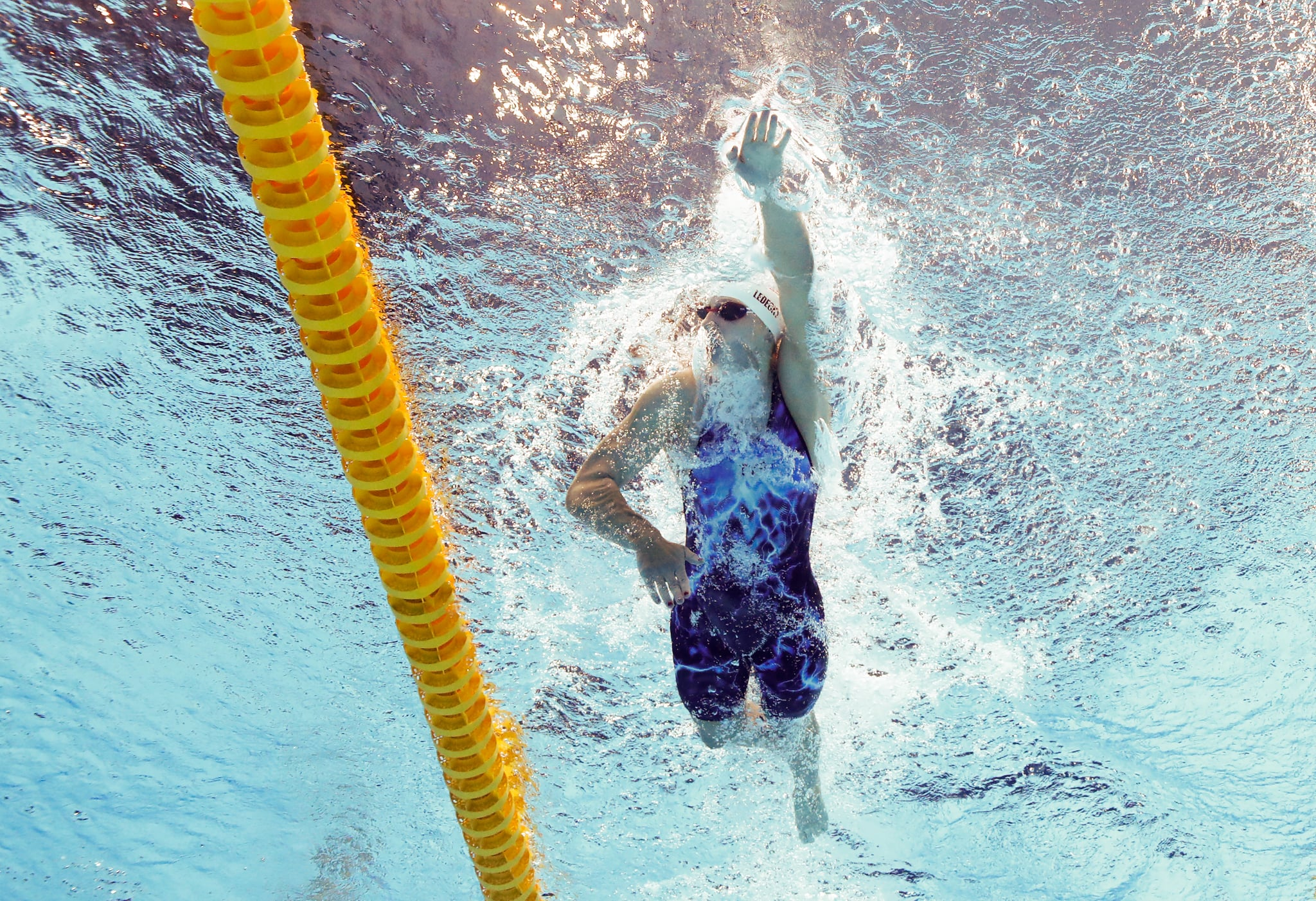 TOKYO, JAPAN - JULY 26: Katie Ledecky of Team United States competes in heat five of the Women's 1500m Freestyle on day three of the Tokyo 2020 Olympic Games at Tokyo Aquatics Centre on July 26, 2021 in Tokyo, Japan. (Photo by Al Bello/Getty Images)