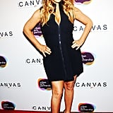 Mariah Carey showed off her body in a tight black dress at the Project Canvas Exhibition & Art Gala in NYC.
