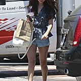 Add a feminine touch to your denim shorts via a peplum blouse just like Selena Gomez.
