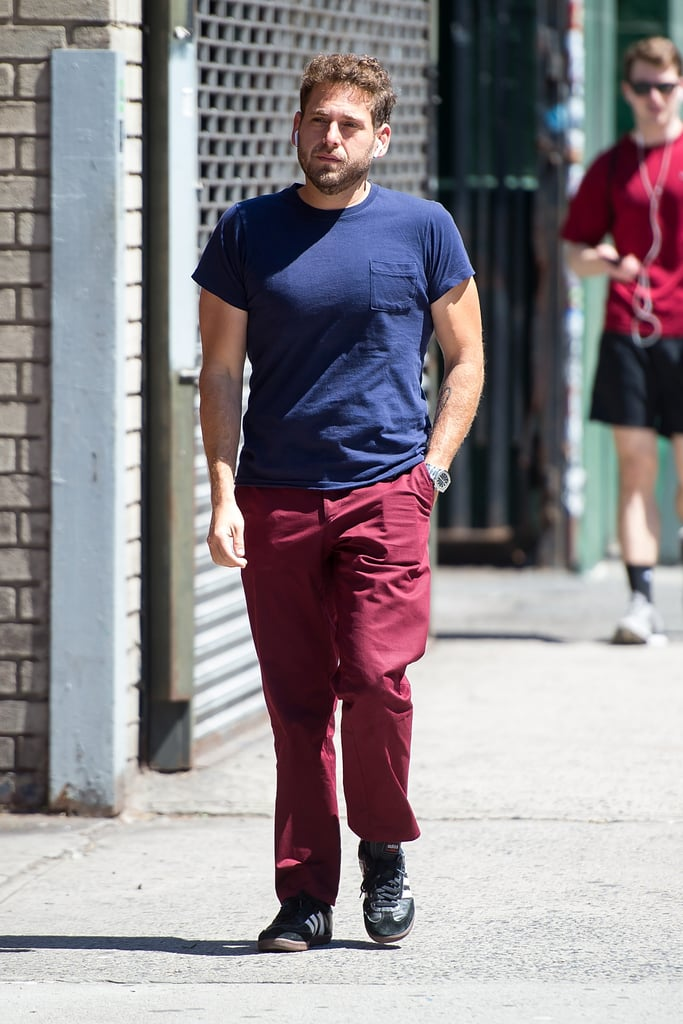 "Jonah Hill was looking all kinds of buff while enjoying a sunny walk in NYC on Sunday. The actor wore a fitted blue t-shirt (a piece we've seen him in before) with red pants and kept his earbuds in as he made his way through NoHo. We first got a glimpse of Jonah's chiseled new physique during a casual stroll in NYC last month, and weeks later, he put his toned arms on display while grabbing a smoothie before a gym session. After gaining 40 pounds for his role in the crime drama War Dogs, Jonah hired a nutritionist and reportedly kept a food journal to lose the weight. He also got some healthy living advice from his 21 Jump Street costar Channing Tatum, whom he called and asked, 'Hey, if I ate less and go to a trainer, will I get in better shape?'""      Related:                                                                                                           Leonardo DiCaprio Pulls an Epic Prank on Jonah Hill on the Streets of NYC"