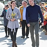 Kate went casual in a wrapped sweater cardigan from Canadian brand Sentaler and R.Soles knee high boots for an afternoon at Carcross Commons. Her shapely earrings were by another Canadian designer, Shelley Silversmith.