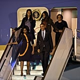 Michelle Obama stepped off the plane in a modest but bold printed dress by Narciso Rodriguez.