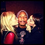 Poppy Delevingne and Alexa Chung planted a kiss on Pharrell Williams — is this a good-looking group or what? Source: Instagram user poppydelevingne