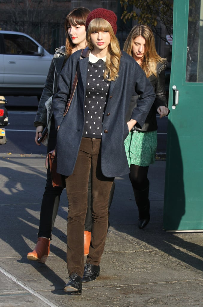 Taylor Swift's NYC ensemble — navy coat, brown corduroys, and black oxfords — was a great canvas to really make her dark-red beanie pop.