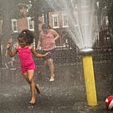 Young girls played in a fountain in NYC's Lower East Side neighborhood during the Big Apple's Summer heat wave.