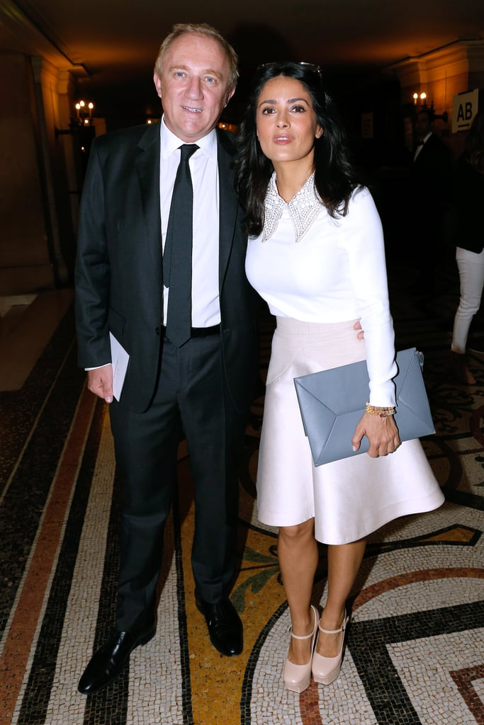 Salma Hayek posed in a pretty ensemble with Francois-Henri Pinault front row at Stella McCartney. She tucked a jewel-collared top into a soft-pink skirt, then finished with an oversize gray clutch and nude Mary Janes.