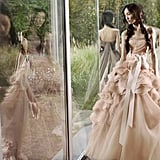 A model catches a glimpse of her ruffled Vera Wang Spring '12 dress in the window. Source: Fashion Gone Rogue
