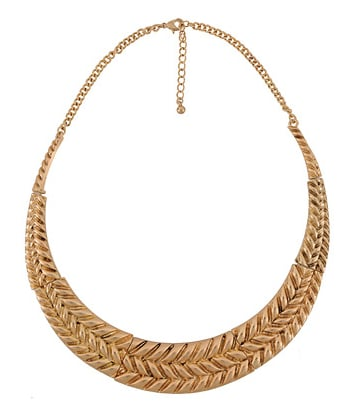 This collared necklace maintains the feeling of a great vintage find.   Forever 21 Textured Collar Necklace ($9)