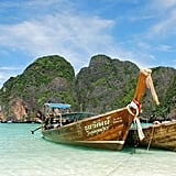 Ride a boat around Phi Phi Island in Thailand.