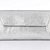 "This Ann Taylor silver glitter clutch ($85) has party written all over it. And it's a good size to fit all your ""I Do"" essentials."