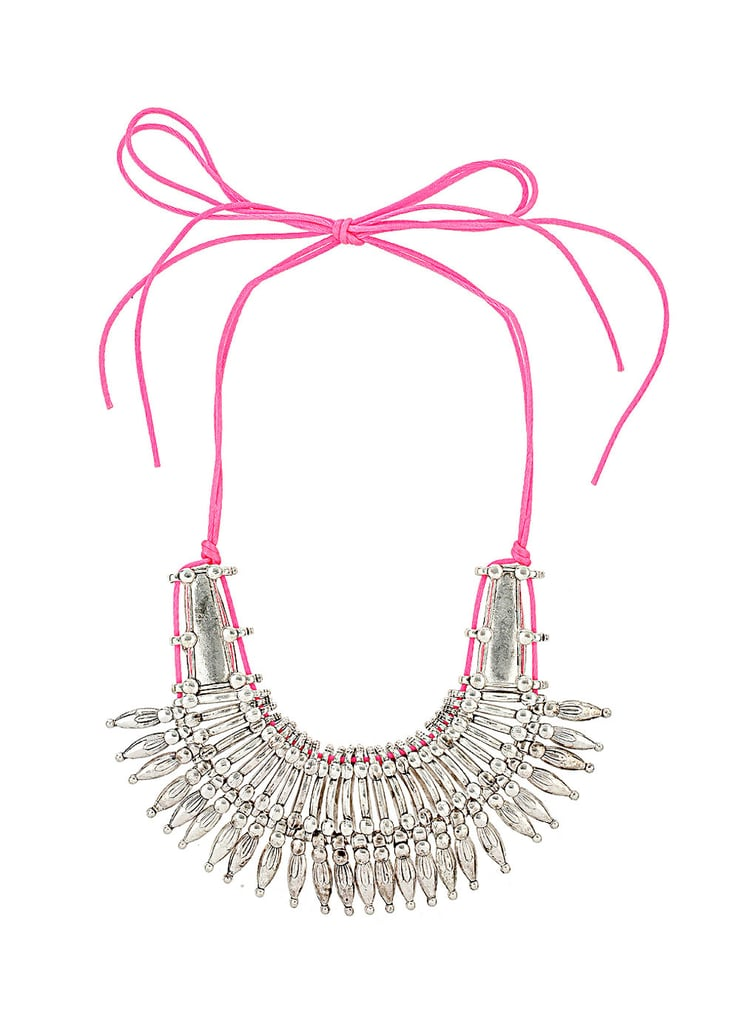 Add a glamorous spin to your usual tee and jeans combo with this Dorothy Perkins's pink neon necklace ($35) — can you believe the price tag?
