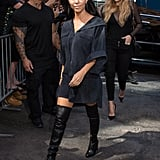 Taking a short shirt dress up a notch with a pair of over-the-knee boots.