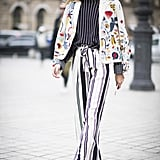 Hack: Contrast stripes of different widths in monochrome shades, then add a trendy little jacket on top that's full of color.