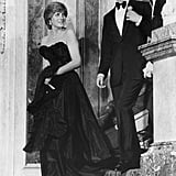 Lady Diana's first public engagement after getting engaged was a charity event, for which she chose a black strapless evening gown that nipped in at the waist. It was the first time she had worn anything by designers the Emanuels, who went on to create her wedding dress.