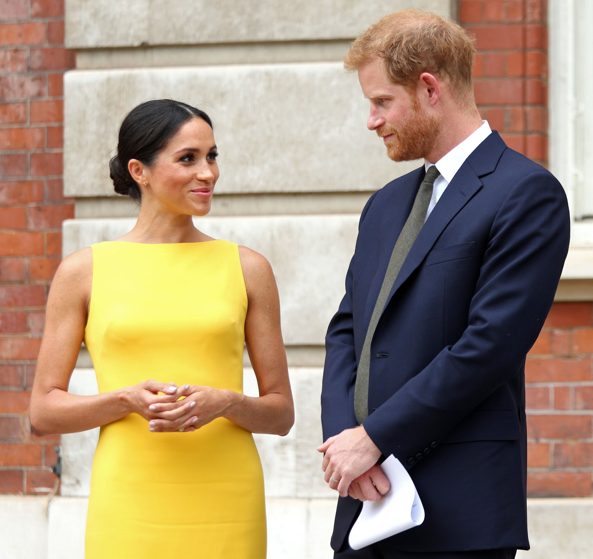 Britain's Prince Harry, Duke of Sussex (R), Britain's Meghan, Duchess of Sussex arrive to attend a reception marking the culmination of the Commonwealth Secretariats Youth Leadership Workshop, at Marlborough House in London on July 5, 2018. (Photo by Yui MOK / POOL / AFP)        (Photo credit should read YUI MOK/AFP/Getty Images)