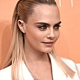 Cara Delevingne's Slicked Back, Half-Up Style, 2019