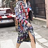 A Colourful Fringed Jacket and Rainbow Patterned Skirt