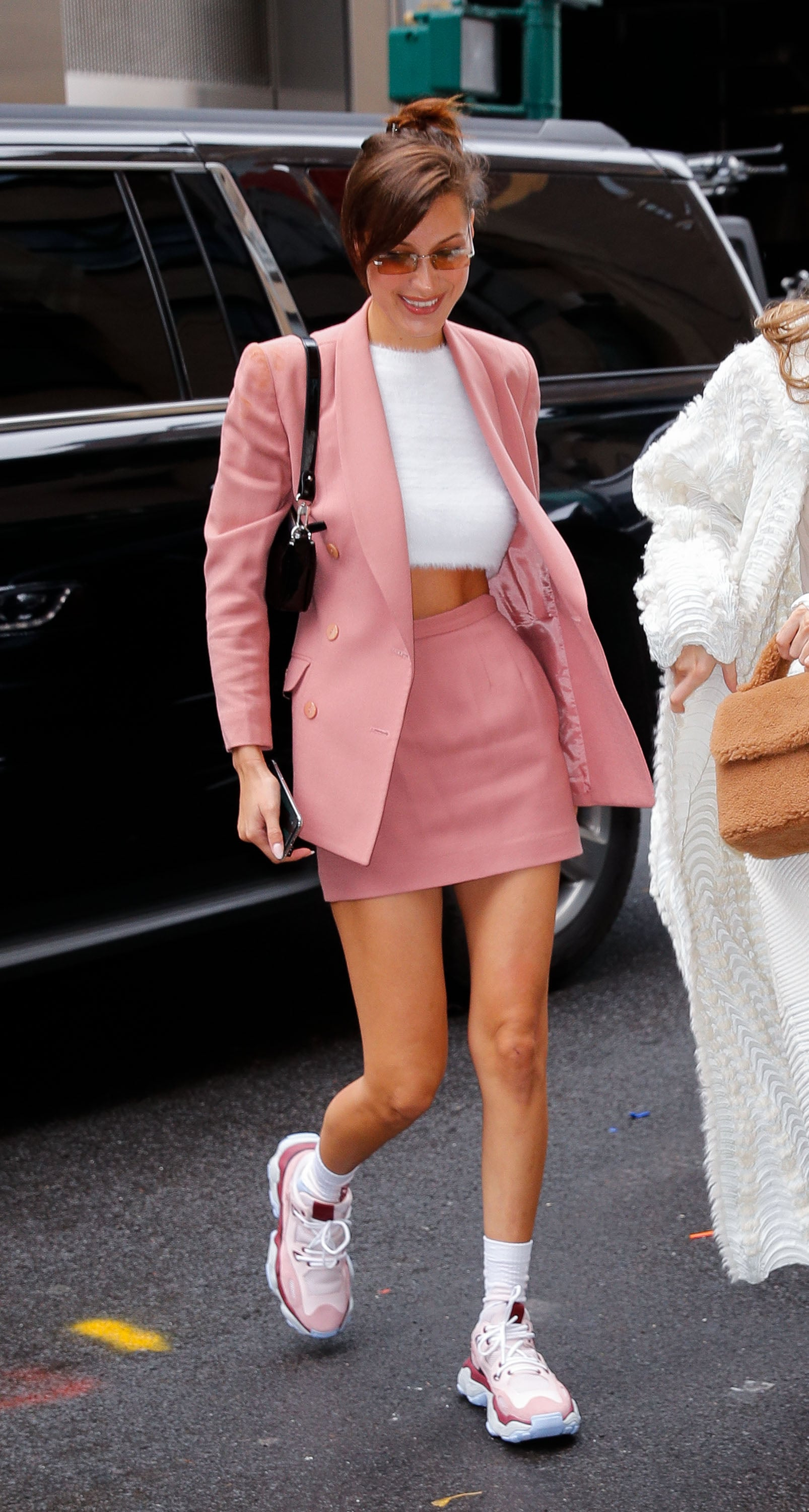 Bella Hadid Rocked a Pink Skirt Suit With an Asos Fuzzy Sweater and Chunky Dad Sneakers | We Can't Wait to Recreate These Model Street Style Looks From Fashion Month | POPSUGAR