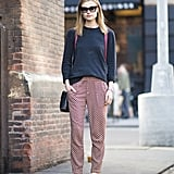 Update your staple Summer knit with a great pair of printed trousers and walkable everyday sandals for a polished look with a touch of the trends. Source: Le 21ème | Adam Katz Sinding