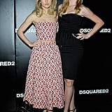 Suki Waterhouse and Ireland Baldwin posed in two different ensembles at the DSquared2 show in Milan. Suki was print happy in a strapless crop top and matching skirt, while Ireland was chic in an LBD.
