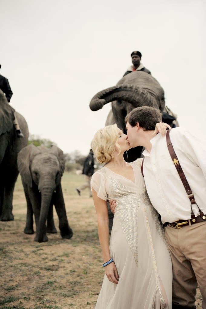 Nolen and Janna traveled to South Africa for their intimate wedding. The ceremony was held at Camp Jabulani, and their aisle was anything but ordinary — it was a line of 12 elephants. See the wedding here!