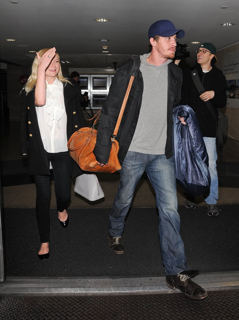 Kirsten Dunst and Garrett Hedlund arrived at LAX together last night. The couple have been dating for a few months now, having met while making On the Road back in 2010. Their picture, directed by Walter Salles, will make its debut this month at the Cannes Film Festival. Hopefully, Kirsten and Garrett will take the opportunity to go public with their romance, but they won't be the only stars on the red carpet supporting their movie. Kristen Stewart also stars, as does Tom Sturridge, Sam Riley, and Amy Adams. Kirsten was just in NYC to attend Monday's Met Ball. For the annual fashion extravaganza, Kirsten Dunst wore a Rodarte suit-dress designed by her good pals Kate and Laura Mulleavy.