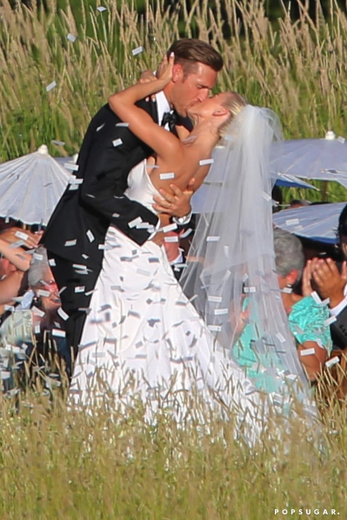 "Julianne Hough looked absolutely stunning on her wedding day. The Dancing With the Stars judge tied the knot with NHL player Brooks Laich during an outdoor ceremony near Coeur d'Alene, ID, on Saturday, and we can't get over what a beautiful pair they make. While Brooks looked handsome in his tuxedo, Julianne rightfully stole the show in her strapless custom Marchesa gown as her dad, Bruce, walked her down the aisle. White confetti then appeared in the air as the two shared their first kiss.  The couple were joined by 200 of their closet friends and family members for the big day, including Aaron Paul and DWTS pro Mark Ballas. Julianne's brother, Derek, also served as a groomsman, while her best friend Nina Dobrev was on hand for bridesmaid duty. ""I've never seen a man look at a woman like that when they said 'I Do,'"" The Vampire Diaries actress said about the romantic wedding. ""It took my breath away."" After toasting to married life and sharing their first dance, which Julianne helped choreograph, the newlyweds made their getaway in a wooden boat on the water.      Related:                                                                                                           22 Stars Who Have Been in Their Famous Friends' Weddings"