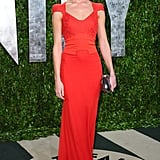 Rosie Huntington-Whiteley wore an elegant red cap-sleeve Antonio Berardi gown paired with a Jimmy Choo and Harry Winston jewels.