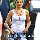 Jennifer Aniston wore a white tank top and short shorts on the set of We're the Millers.
