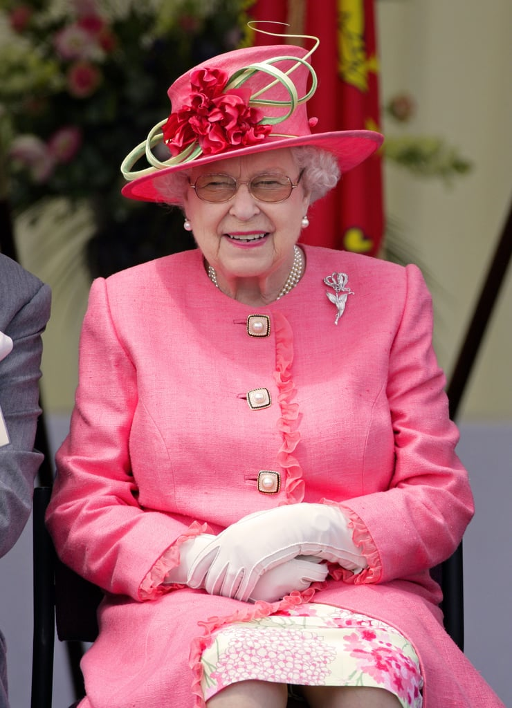 Queen Elizabeth II stepped out in July 2012 in a flurry of bright pinks and dramatic florals.