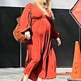 Jessica Simpson covered her baby bump in a flowing dress.