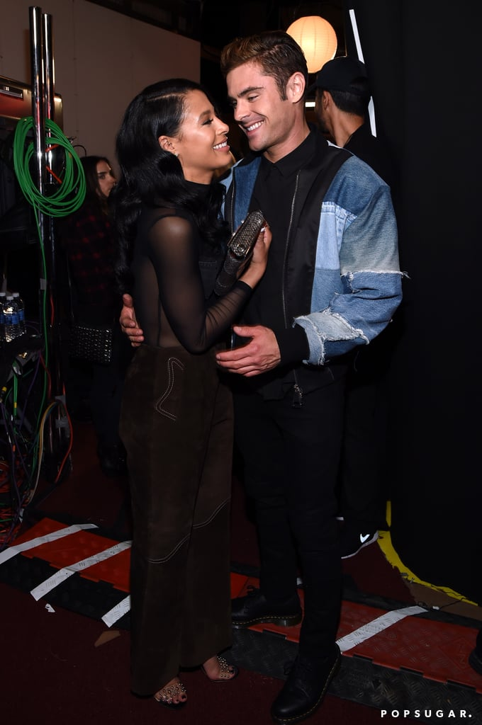 Just when you thought the MTV Movie Awards couldn't get any hotter, Zac Efron and Sami Miró show up. On Saturday, the couple put on quite the loving display while posing for photos backstage, adding to their long list of sweet moments together. This is just the latest we've seen of the pair together since they popped up at the Saint Laurent fashion show back in February, although Zac has been hard at work filming Baywatch alongside Dwayne Johnson in Florida. Keep reading to see more of the duo's sweet night, and then flip through Zac's hottest shirtless pictures of all time.