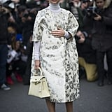 If your end-of-week plans involve a brunch or afternoon party and a polished look is required, consider using a pastel-hued accessory as the final touch to your look. Miroslava Duma's brocade coat would be chic enough on its own, but the addition of a buttery-yellow top-handle bag finishes it off perfectly.