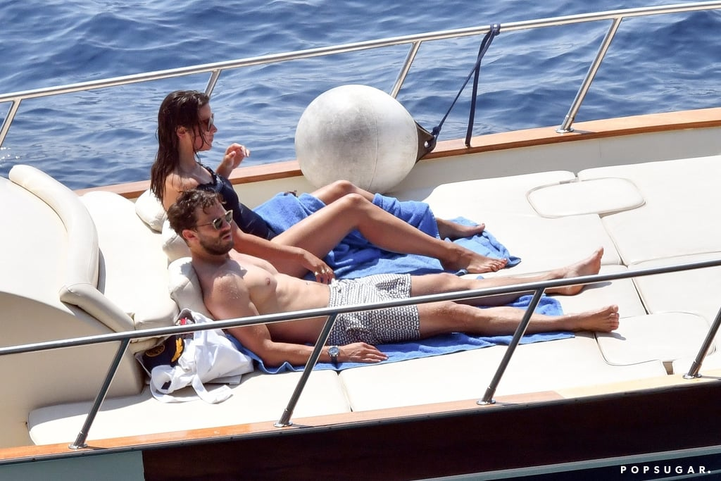 "It seems like almost every celebrity couple decided to spend their Summer in Europe this year, and Jamie Dornan and Amelia Warner are no exception. The couple are currently enjoying a relaxing vacation in Italy, and on Wednesday, they were seen out and about in Nerano. Jamie and Amelia appeared to be in good spirits as they grabbed a bite to eat at Lo Scoglio restaurant before going for a boat ride in the Italian sea. The following day, Jamie and Amelia went for a dip in the sea, and it looks like Jamie heard our prayers, because this time around, Jamie ditched his shirt and blessed us with several glimpses of his sexy, chiseled physique.  Jamie and Amelia's getaway comes a week after the actor helped launch NI PanC, a support group for cancer survivors and relatives of cancer patients, at Mater Hospital in Belfast. Jamie lost his mother, Lorna Dornan, to pancreatic cancer at the age of 16, and he decided to join forces with the charity in her honor. ""I've always wanted to be associated to a charity that means something to me in a major way,"" Jamie explained. ""It all seemed very fitting, I could do whatever I can to promote awareness of this horrendous disease.""       Related:                                                                                                           11 Times Jamie Dornan and Wife Amelia Warner Couldn't Take Their Eyes Off Each Other"