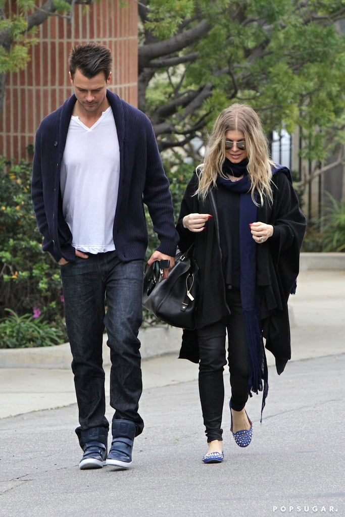 Josh Duhamel and Fergie both wore black and navy.