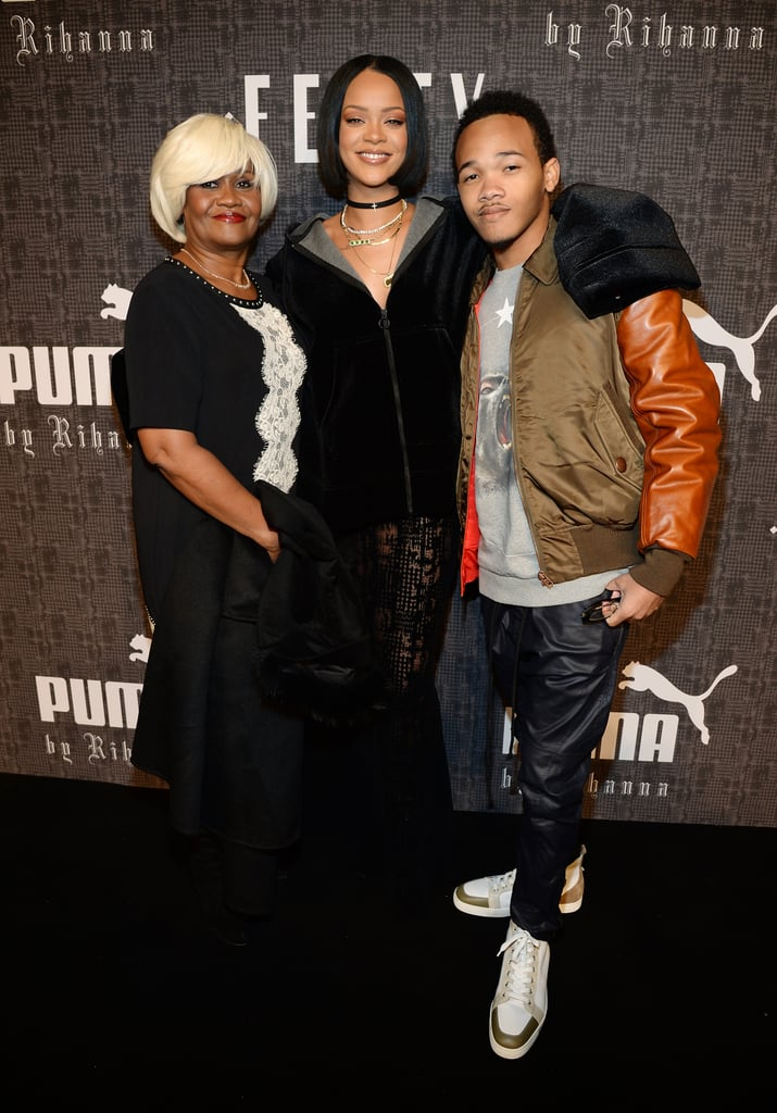 "All eyes were on Rihanna in the Big Apple on Friday night: the singer presented her sexy, gothic-chic Fall '16 Fenty collaboration with Puma during New York Fashion Week and was her usual stunning self while posing for photos with her mum, Monica Braithwaite, and younger brother Rajad, as well as fashion designer Jeremy Scott, famed stylist Carlyne Cerf de Dudzeele, and Puma CEO Bjorn Gulden. Inside, more of Rihanna's famous friends showed their support — Gigi and Bella Hadid stomped the runway, while the front row was occupied by the likes of Naomi Campbell, Chris Rock, and Anna Wintour. It's already shaping up to be a big year for Rihanna, who released her highly anticipated eighth album, Anti, in January and is gearing up to go on tour. She'll also be performing at the Grammys this Tuesday, but don't expect her to show up with a date: during a recent appearance on The Ellen DeGeneres Show, Rihanna talked up her single status and played a hilarious (and candid) game of ""Never Have I Ever"" with George Clooney. Keep reading for pictures from Rihanna's night at NYFW, and then find out if she should be your spirit guide this year."
