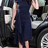 Meghan offset her deep navy blue Roland Mouret dress with Manolo Blahnik pumps in a lighter tone the night before her wedding in May 2018.