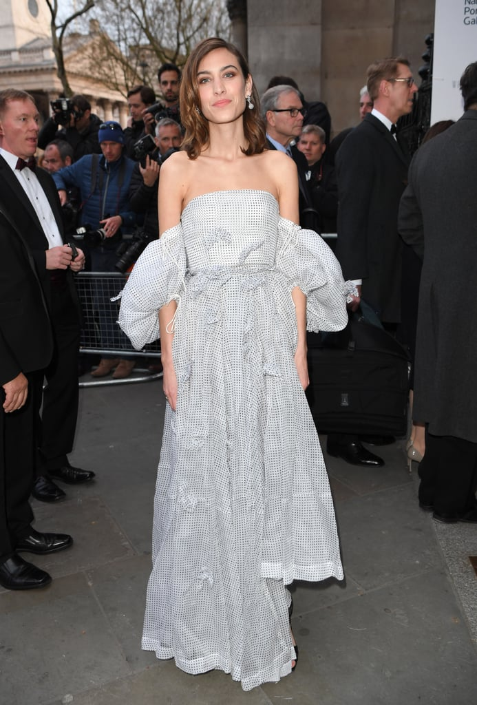 "Whether it's last night's lasagna or you've just returned from Itsu, Alexa Chung just wore a Loewe dress that'll make you spit out your lunch; it's that good. Attending the National Portrait Gala on Tuesday evening, the British presenter, Vogue contributing editor, and queen of beauty looks continued her fashion winning streak with a J.W. Anderson-designed off-the-shoulder dress. Pairing the look with bow-detail sandals and a Prada clutch, this outfit wins a special place in our hearts — that place being the home of the ""best Springtime evening gala get-up of all time."" Keep reading to see Alexa's ensemble from all angles, then add a seasonal touch to your wardrobe and shop the style for yourself.       Related:                                                                                                           Alexa Chung Reveals the Trend She Tried – and Failed – to Start"