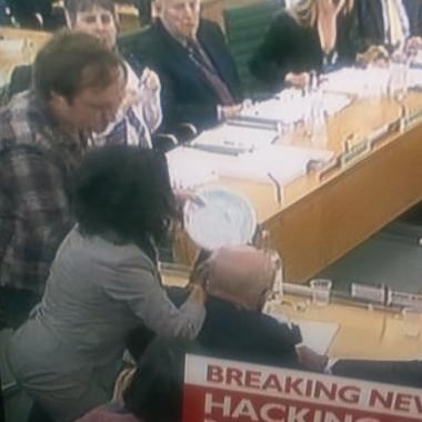 Wendi Murdoch Slaps Pie Thrower in Parliament (Video)