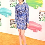 Kristen Stewart hit the orange carpet in a blue lace Stella McCartney minidress with a matching blue satin belt.