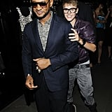 Justin Bieber stayed close to Usher during a 2011 party at Dolce & Gabbana.