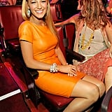 Blake Lively in orange Gucci.