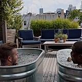 The rooftop deck features an outdoor living area and views of the city.