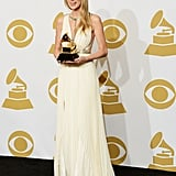 "Taylor Swift posed with her Grammy for best song written for visual media for her ""Safe and Sound"" track."