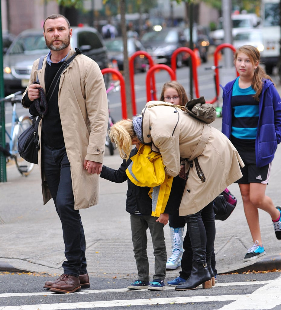 Naomi Watts planted a kiss on her son Sasha while out with Liev Schreiber and her other son Kai.